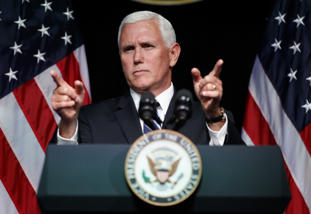 FILE - In this Aug. 9, 2018 file photo, Vice President Mike Pence gestures during an event on the creation of a U. S. Space Force at the Pentagon.  Wi...