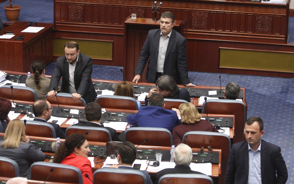 Lawmakers of the ruling SDSM wait before voting for the proposal on a motion for constitutional revision during a session of the Macedonian Parliament...