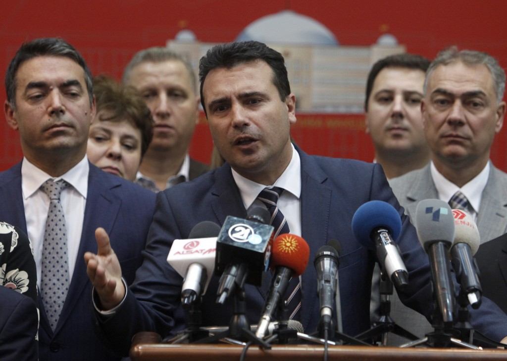 Macedonian Prime Minister Zoran Zaev, center, talks for the media after the parliament voted for the proposal on a motion for constitutional revision