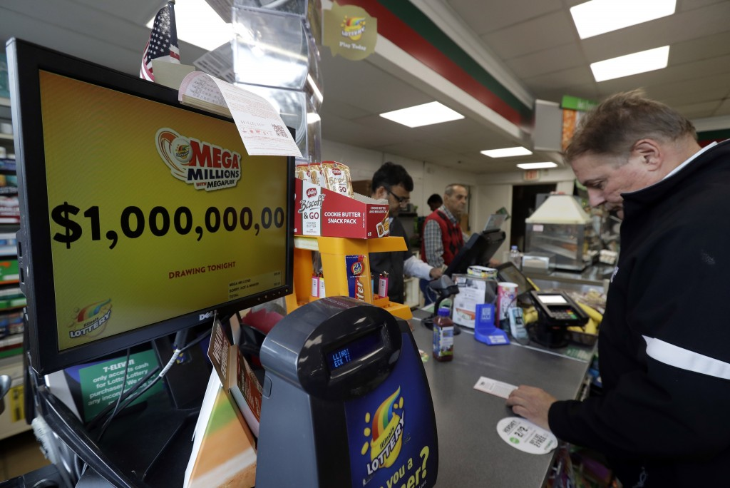 A sign displays the estimated Mega Millions jackpot at a convenience store in Chicago, Friday, Oct. 19, 2018. Friday's jackpot has soared to $1 billio