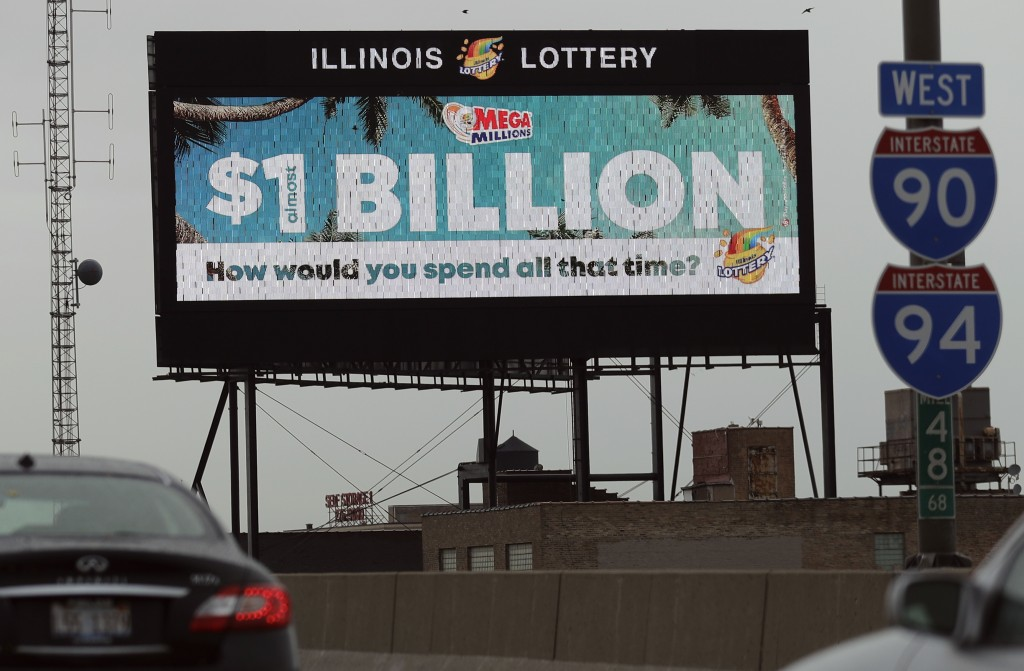 A digital billboard along I-90/94 highway in Chicago, displays the estimated Mega Millions jackpot, Friday, Oct. 19, 2018. Friday's jackpot has soared