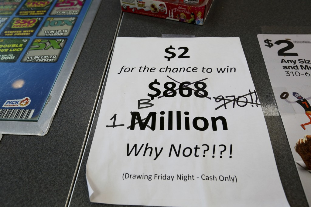 An updated paper sign is displayed the counter of a 7-Eleven store shows that the Mega Millions estimated jackpot has soared to $1 billion, as the sec