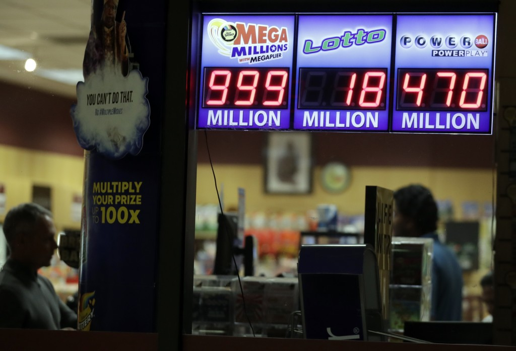 A sign displays the estimated Mega Millions jackpot at a convenience store in Chicago, Friday, Oct. 19, 2018. Friday's jackpot has soared to $1 billio...
