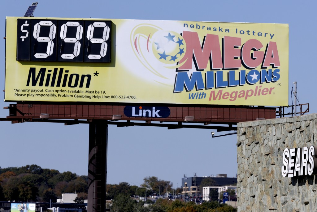 A Mega Millions billboard in Omaha, Neb., adjacent to a Sears store, shows 999 million, the maximum number it can show, ahead of the lottery draw, Fri