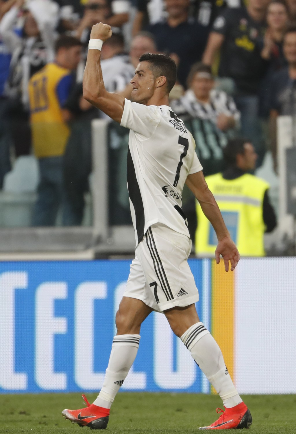 Juventus' Cristiano Ronaldo celebrates after scoring his team's first goal during an Italian Serie A soccer match between Juventus and Genoa, at the A...