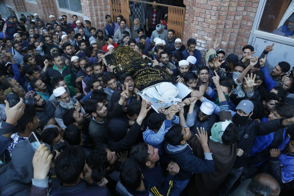 Kashmiri villagers carry the body of Uzair Mushtaq during his funeral in Kulgam 75 Kilometers south of Srinagar, Indian controlled Kashmir, Sunday, Oc...