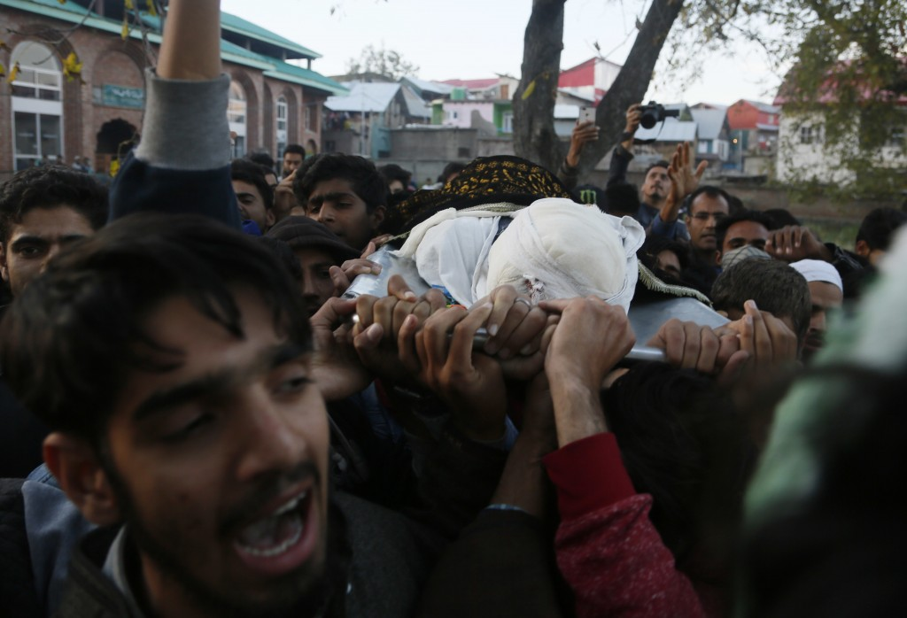 Kashmiri villagers shout pro-freedom slogans as they carry the body of Uzair Mushtaq during his funeral in Kulgam 75 Kilometers south of Srinagar, Ind
