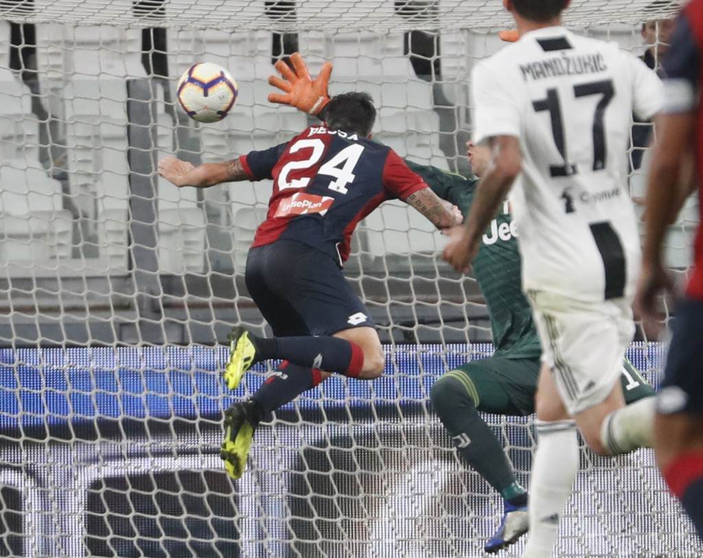 Genoa's Daniel Bessa scores the equalizer during an Italian Serie A soccer match between Juventus and Genoa, at the Alliance stadium in Turin, Italy,