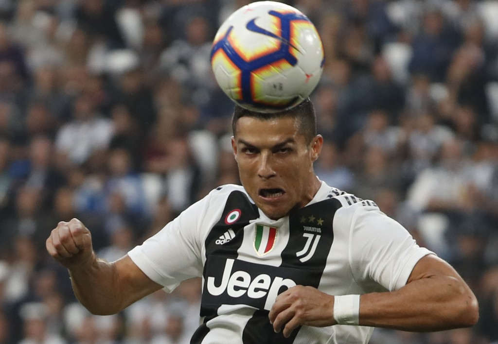 Juventus' Cristiano Ronaldo heads the ball to hit the post during an Italian Serie A soccer match between Juventus and Genoa, at the Alliance stadium