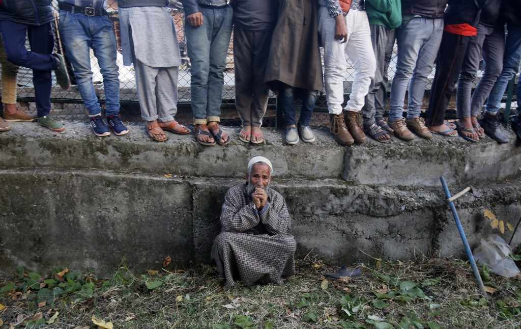 An elderly Kashmiri villager cries during the funeral of Uzair Mushtaq in Kulgam 75 Kilometers south of Srinagar, Indian controlled Kashmir, Sunday, O...