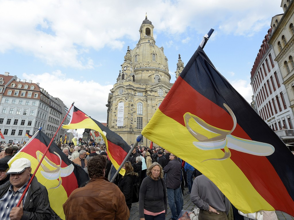 People take part in a rally of PEGIDA (Patriotic Europeans against the Islamization of the West) in Dresden, Germany, Sunday, Oct.21, 2018. (AP Photo/