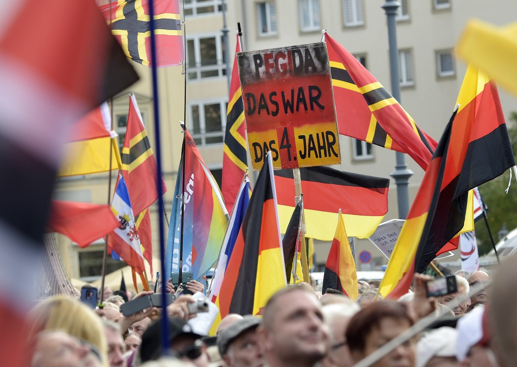 "People carry a sign reading ""PEGIDA that was your fourth year"" during a rally of PEGIDA (Patriotic Europeans against the Islamization of the West) in"