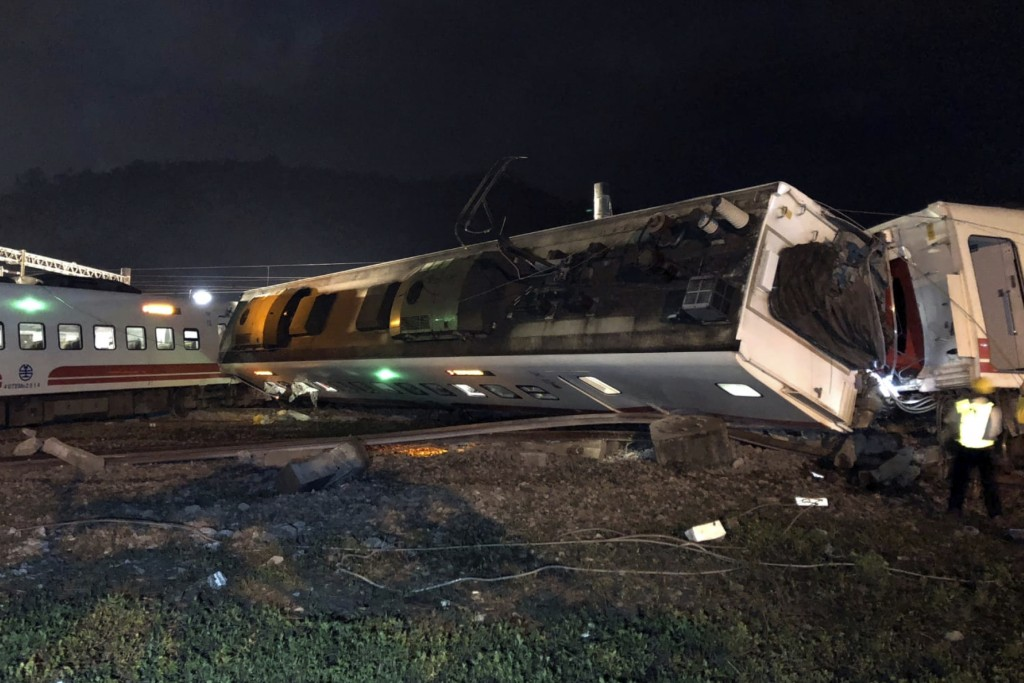 CORRECTS PLACE - In this photo released by Taiwan Railways Administration, train carriages are scattered at the site of a train derailment in Yilan co...