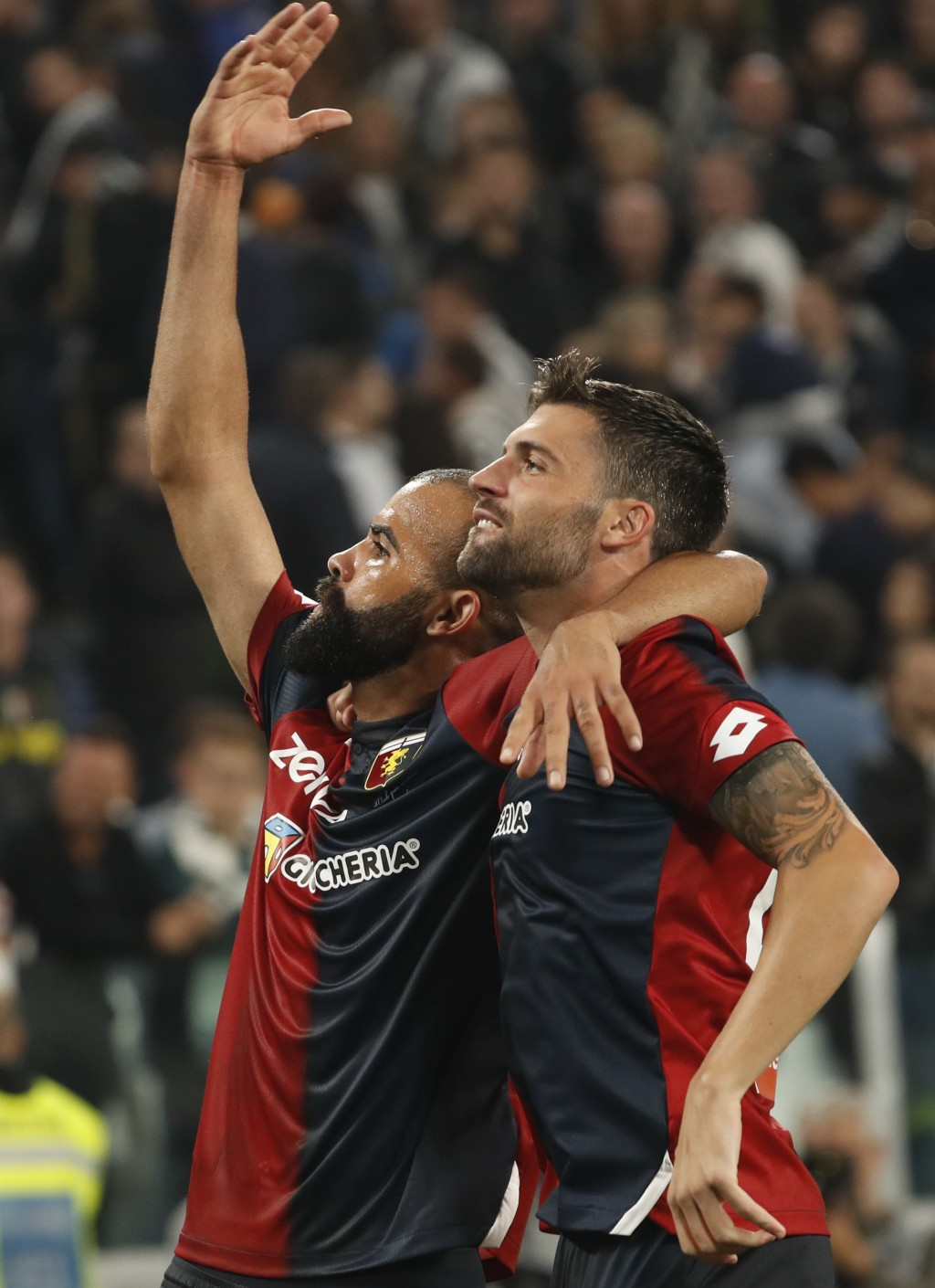 Genoa's Daniel Bessa, right, who scored the equalizer, and Genoa's Sandro celebrate at the end of an Italian Serie A soccer match between Juventus and