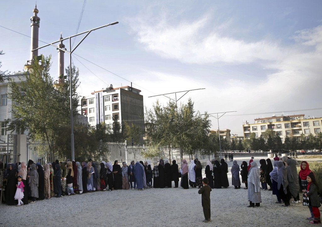 Women line up to vote at during the second day of Parliamentary elections in Kabul, Afghanistan, Sunday, Oct. 21, 2018. The elections were extended in