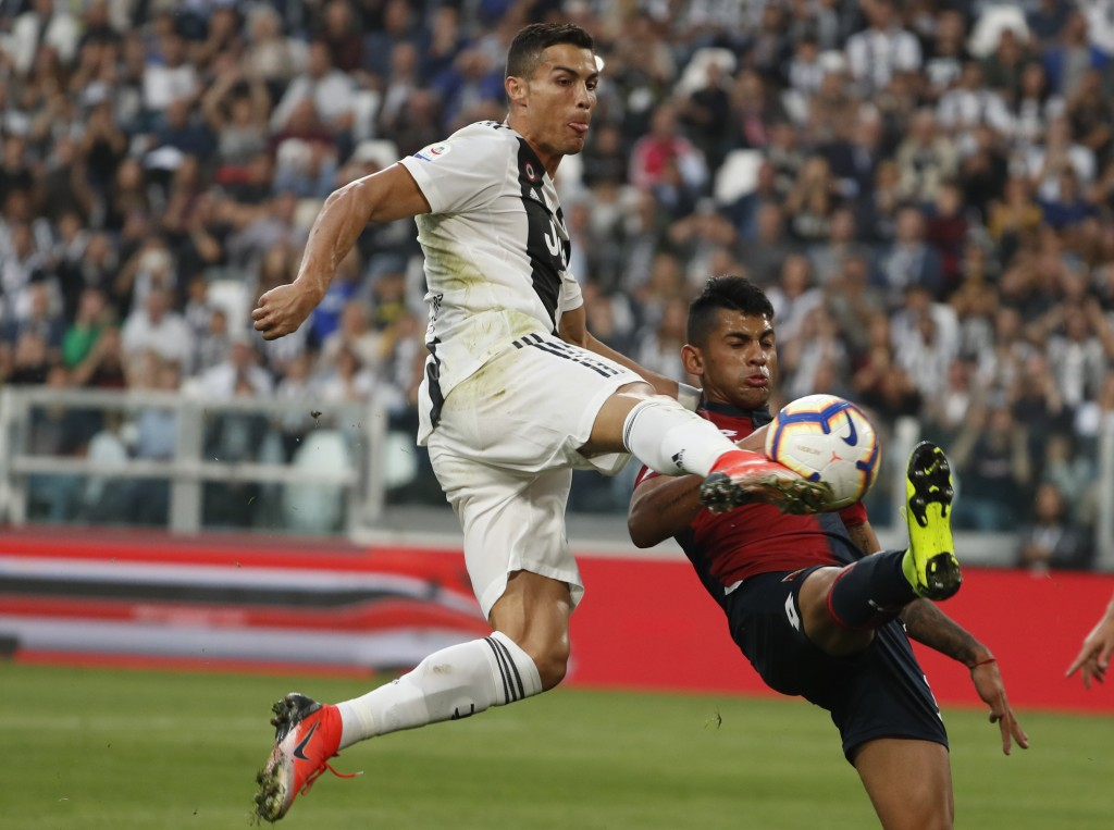 Juventus' Cristiano Ronaldo tries to score during an Italian Serie A soccer match between Juventus and Genoa, at the Alliance stadium in Turin, Italy,...