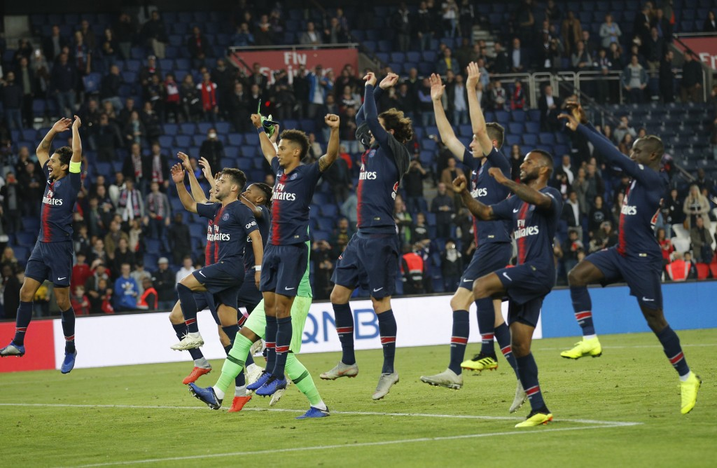 PSG players celebrate their victory during the French League One soccer match between Paris-Saint-Germain and Amiens at the Parc des Princes stadium i...