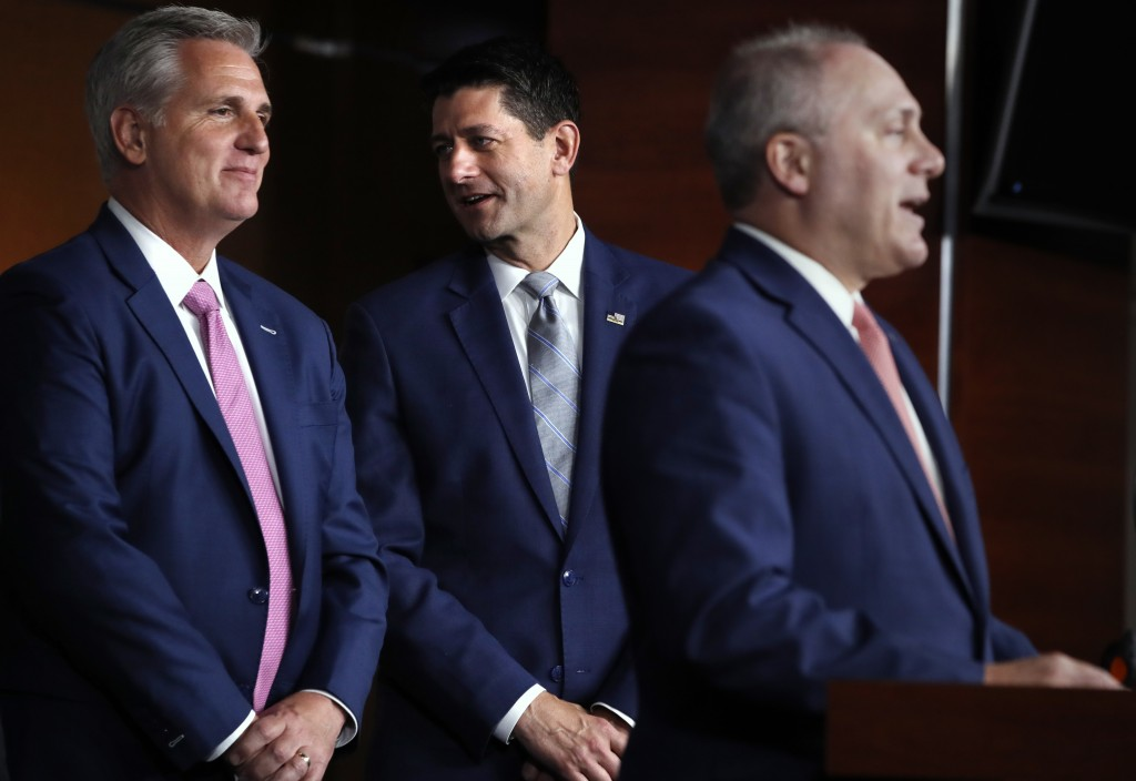 FILE - In this Sept. 13, 2018 file photo, House Speaker Paul Ryan of Wis., center, talks with House Majority Leader Kevin McCarthy of Calif., left, wh