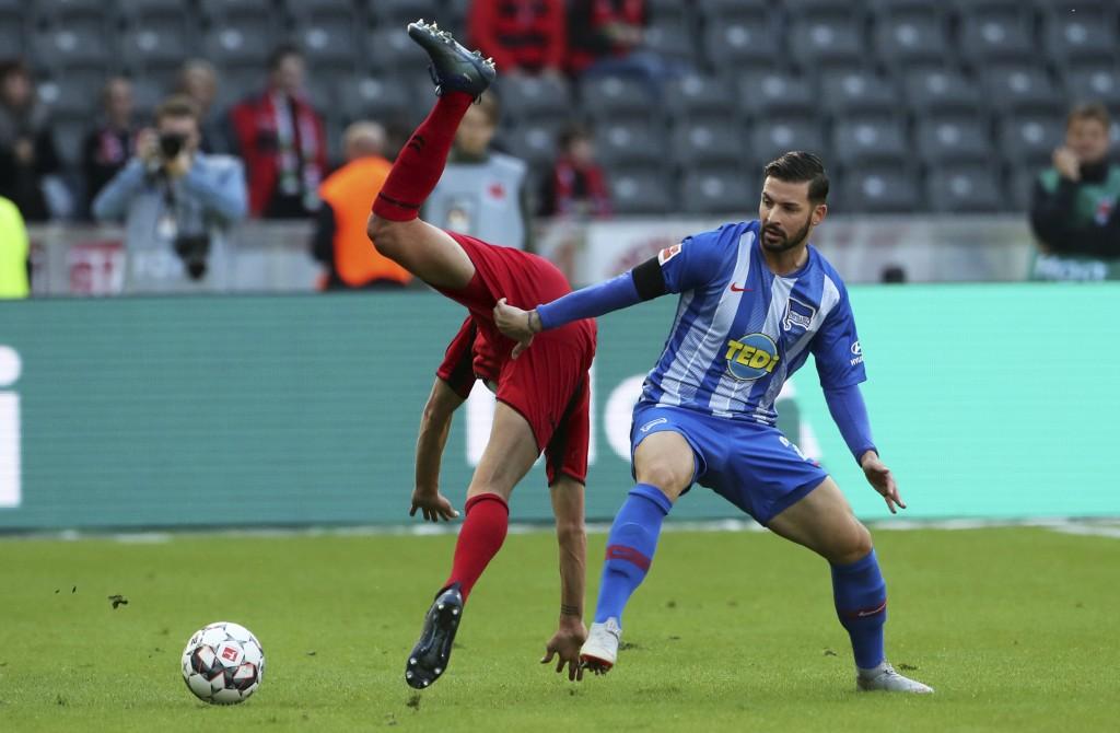 Hertha's Marvin Plattenhardt, right, and Freiburg's Janik Haberer  challenge for the ball during a German Bundesliga soccer match between Herthas BSC