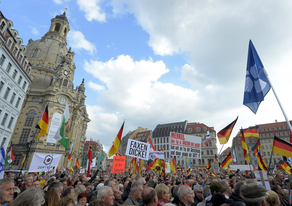 People take part ib a rally of PEGIDA (Patriotic Europeans against the Islamization of the West) in Dresden, Germany, Sunday, Oct.21, 2018. (AP Photo/...