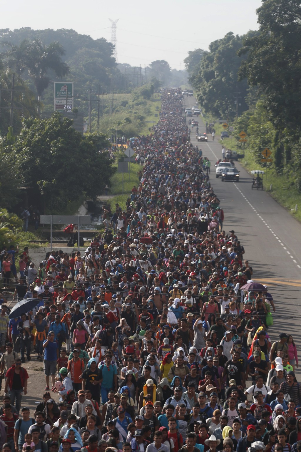 Central American migrants walking to the U.S. start their day departing Ciudad Hidalgo, Mexico, Sunday, Oct. 21, 2018. Despite Mexican efforts to stop