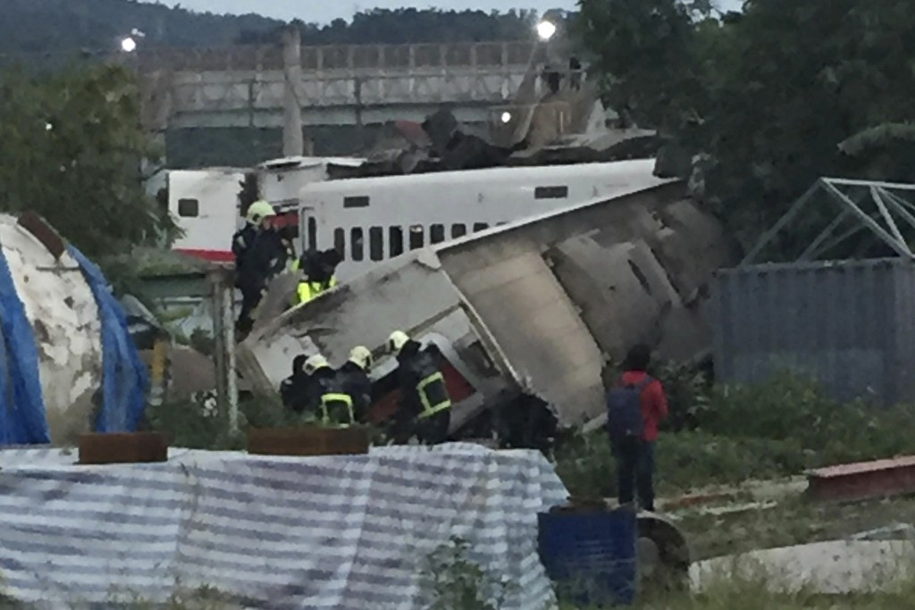 CORRECTS PLACE - In this photo released by Li Jun, rescue workers are seen at the site of a train derailment in Yilan county northeastern Taiwan on Su