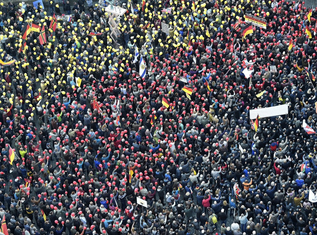 People hold balloons in the colors of the German national flag during a rally of PEGIDA (Patriotic Europeans against the Islamization of the West) in