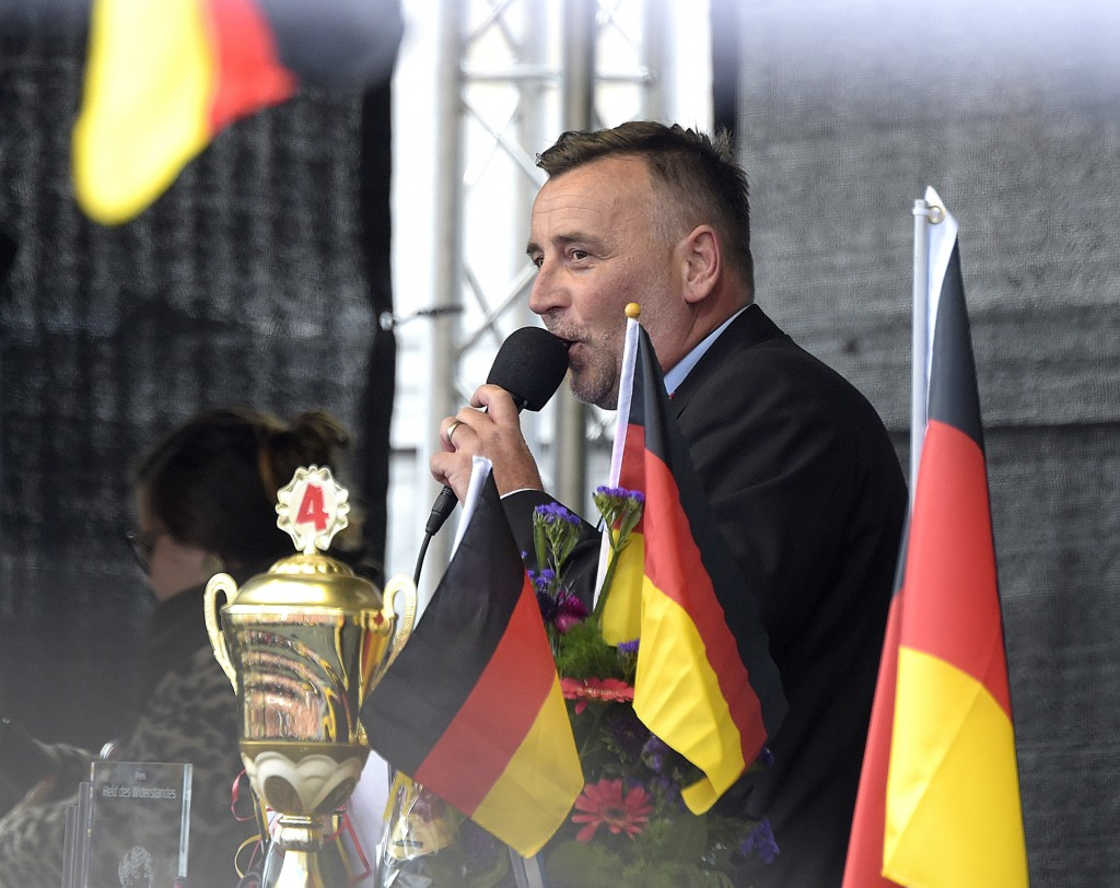 PEGIDA founder Lutz Bachmann speaks during a rally of PEGIDA (Patriotic Europeans against the Islamization of the West) in Dresden, Germany, Sunday, O