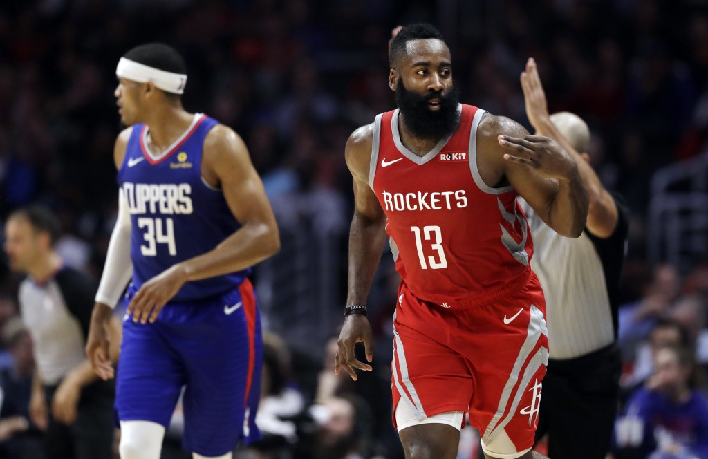 Houston Rockets' James Harden (13) gestures after making a 3-point basket against the Los Angeles Clippers during the first half of an NBA basketball ...