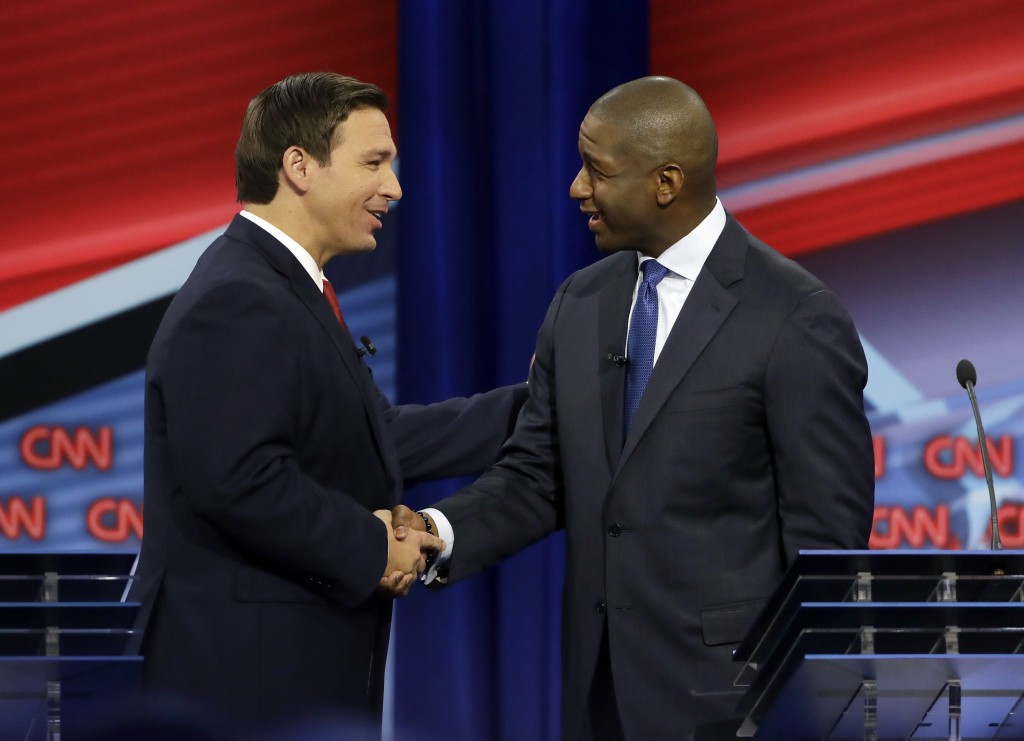 Florida gubernatorial candidates, Republican Ron DeSantis, left, and Democrat Andrew Gillum meet after a CNN debate, Sunday, Oct. 21, 2018, in Tampa, ...