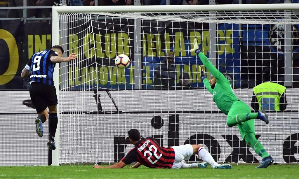 Inter Milan's Mauro Icardi, left, scores during the Serie A soccer match between Inter Milan and AC Milan at the San Siro Stadium in Milan, Italy, Sun