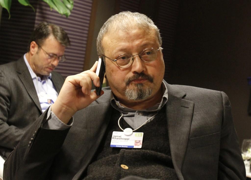 FILE - In this Jan. 29, 2011, file photo, Saudi Arabian journalist Jamal Khashoggi speaks on his cellphone at the World Economic Forum in Davos, Switz