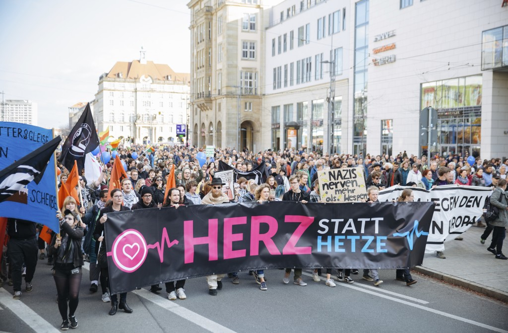 "People attend a demonstration called ""heart instead of hounding"" to protest against a far right PEGIDA demonstration in Dresden, eastern Germany, Sund"