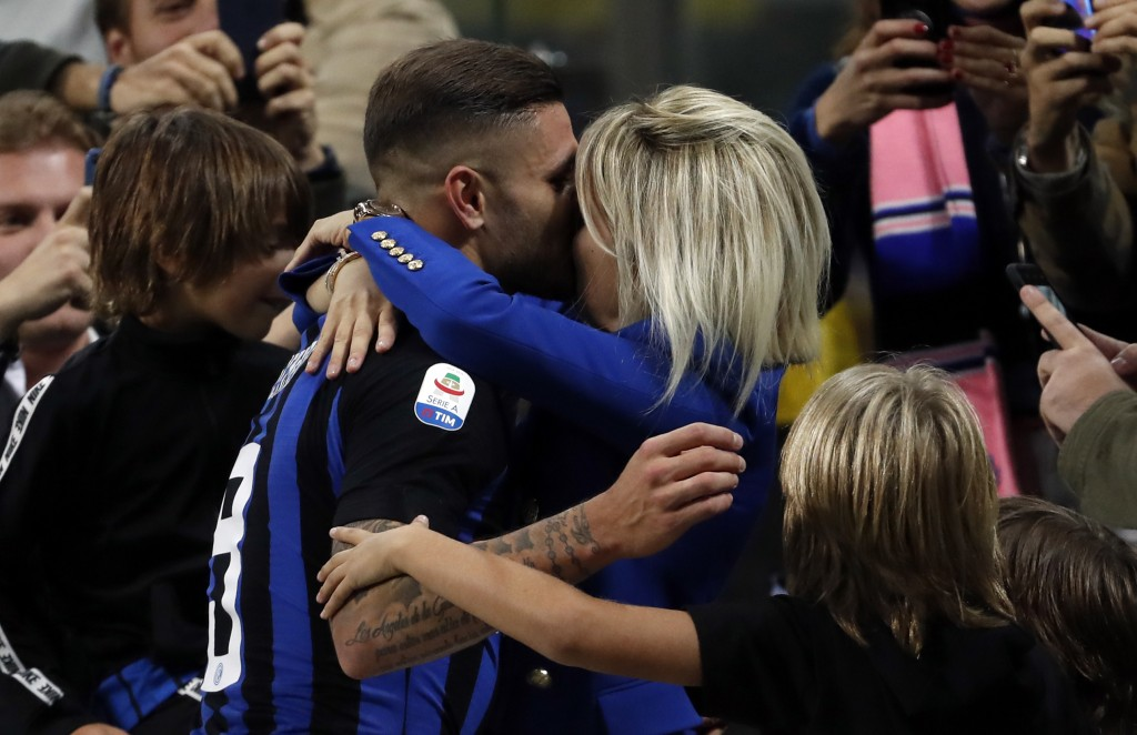 Inter Milan's Mauro Icardi, center, celebrates with his family after scoring during the Serie A soccer match between Inter Milan and AC Milan at the S...