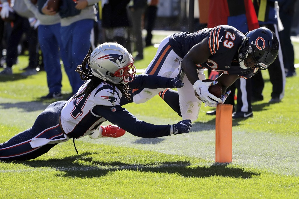 Chicago Bears running back Tarik Cohen (29) dives to the end zone against New England Patriots cornerback Stephon Gilmore (24) for a touchdown during