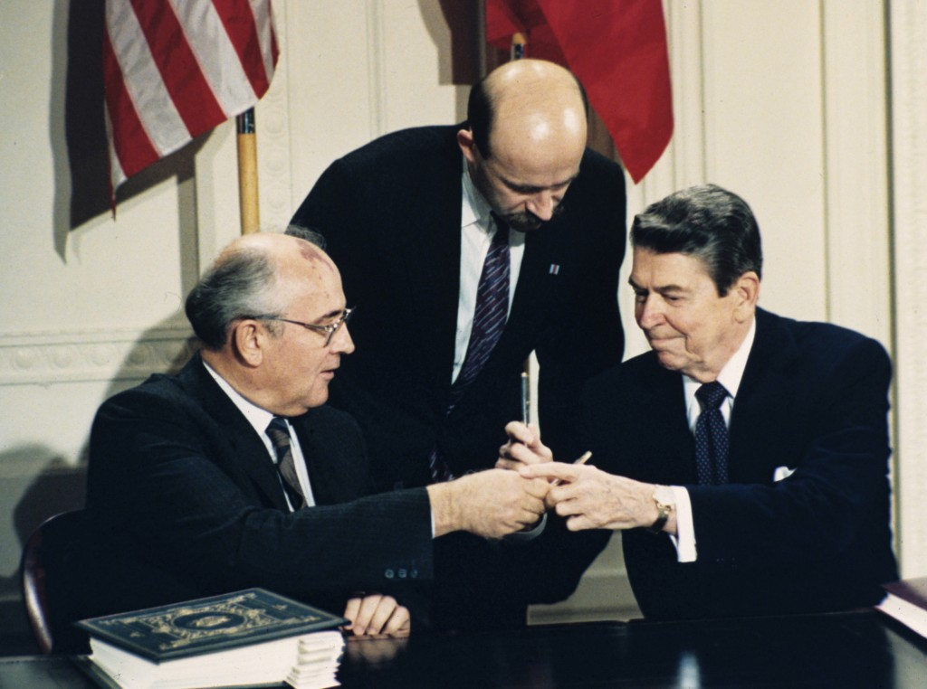 FILE - In this Dec. 8, 1987 file photo U.S. President Ronald Reagan, right, and Soviet leader Mikhail Gorbachev exchange pens during the Intermediate ...