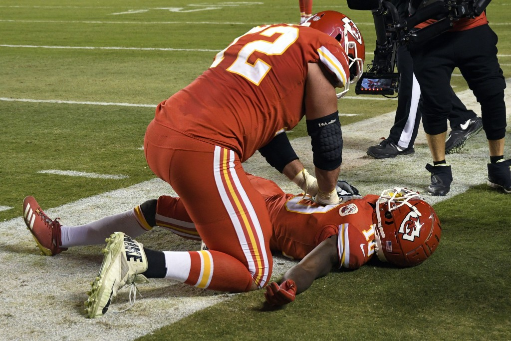 Kansas City Chiefs offensive lineman Eric Fisher (72) pretends to do CPR on wide receiver Tyreek Hill (10) after Hill scores a touchdown during the se...
