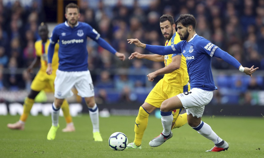 Everton's Andre Gomes, right, in action against Crystal Palace during their English Premier League soccer match at Goodison Park in Liverpool, England