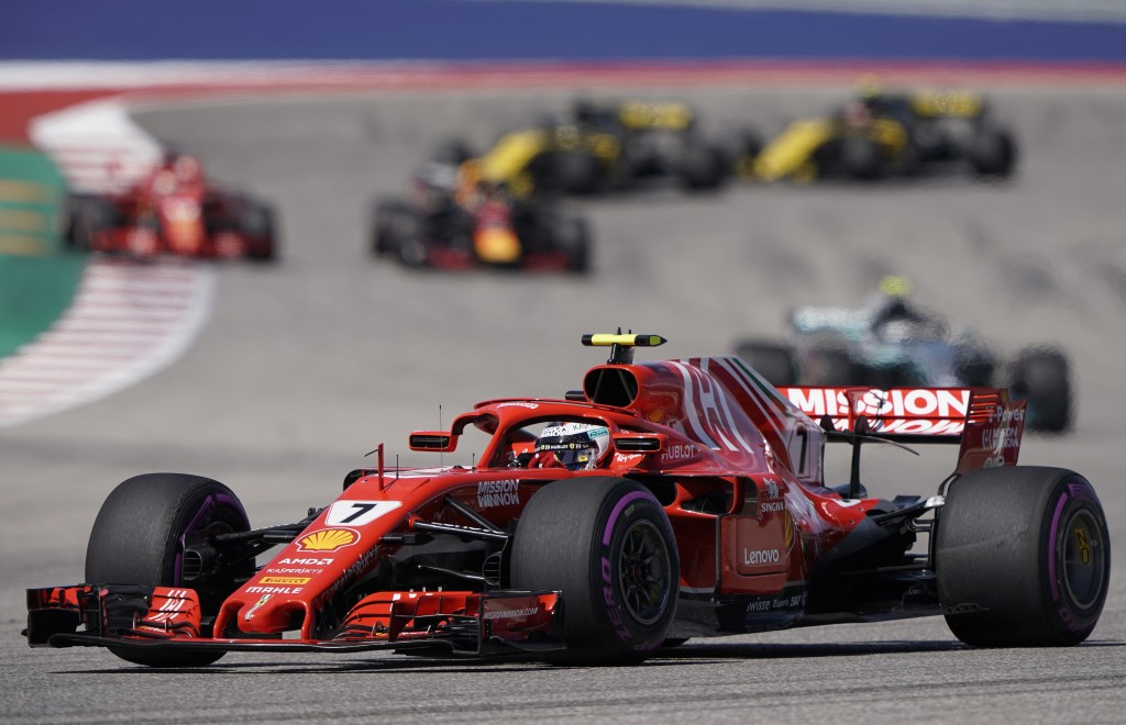 Ferrari driver Kimi Raikkonen, of Finland, drives his car during the Formula One U.S. Grand Prix auto race at the Circuit of the Americas, Sunday, Oct