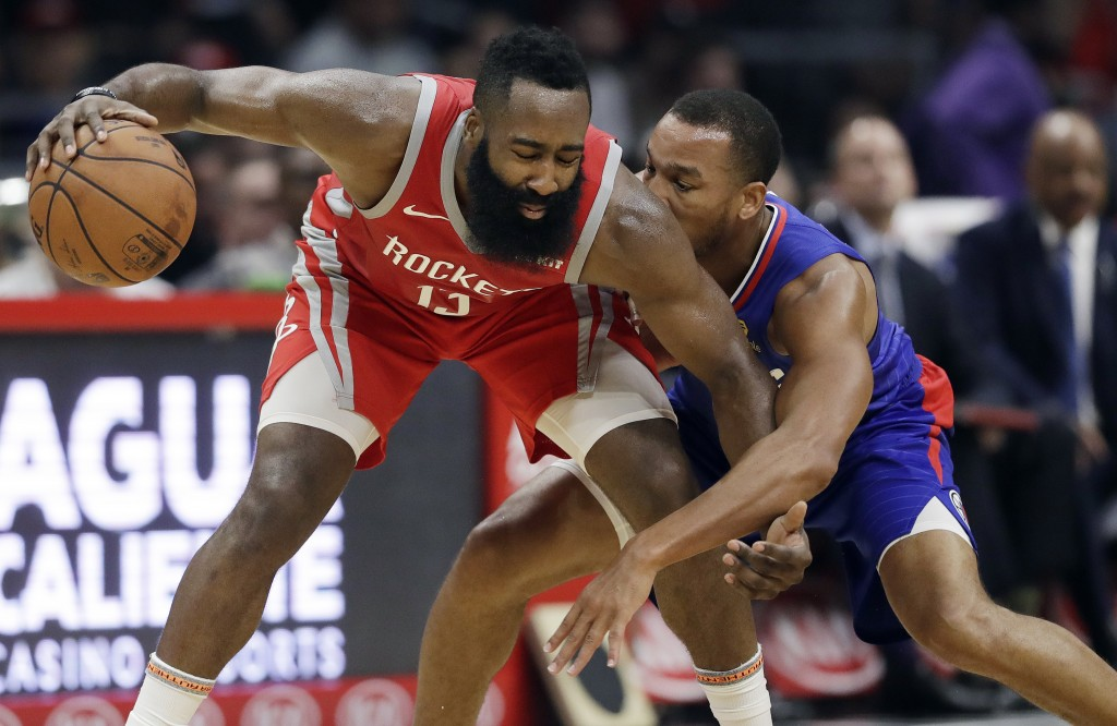 Houston Rockets' James Harden (13) is defended by Los Angeles Clippers' Avery Bradley during the first half of an NBA basketball game Sunday, Oct. 21,