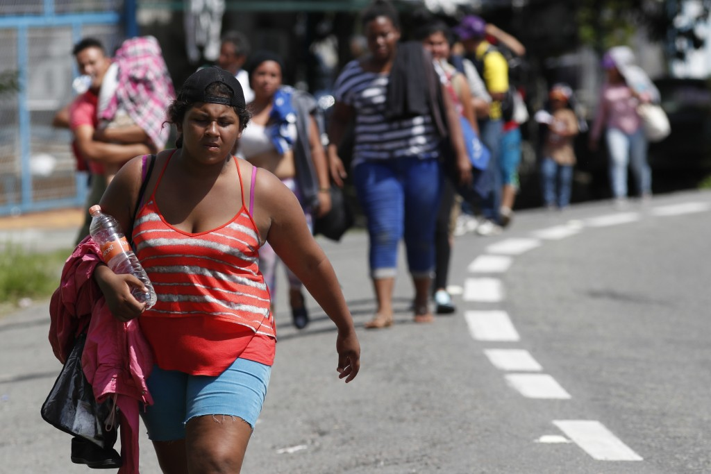 Central American migrants making their way to the U.S. arrive by foot to Tapachula, Mexico, Sunday, Oct. 21, 2018. Despite Mexican efforts to stop the...