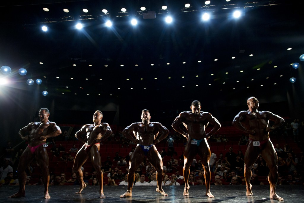 In this Thursday, Oct. 18, 2018 photo, contestants participate in the final round during the National Amateur Body Builders' Association competition i...