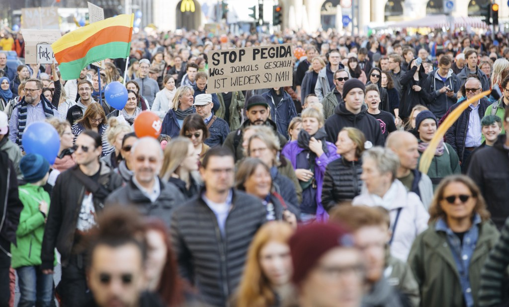 "People attend a demonstration called ""heart instead of hounding"" to protest against a far right PEGIDA demonstration in Dresden, eastern Germany, Sund..."