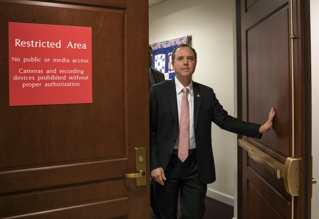 FILE - In this March 22, 2018 file photo, Rep. Adam Schiff, D-Calif., ranking member of the House Intelligence Committee, exits a secure area to speak