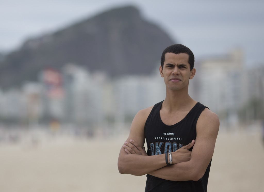 In this Oct. 16. 2018 photo, event promoter Peter Rooker poses for a portrait at Copacabana beach in Rio de Janeiro, Brazil. In the lead up to Brazil'...