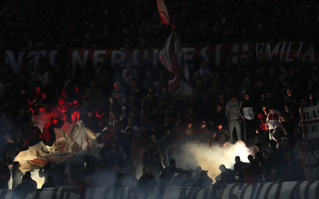 AC Milan's supporters burn flares during the Serie A soccer match between Inter Milan and AC Milan at the San Siro Stadium, in Milan, Italy, Sunday, O