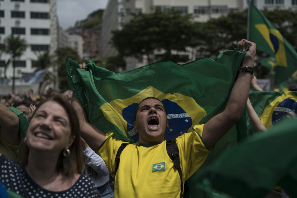 A man yells after listening to the Brazil's anthem during a campaign rally for presidential candidate Jair Bolsonaro, of the far-right Social Liberal ...