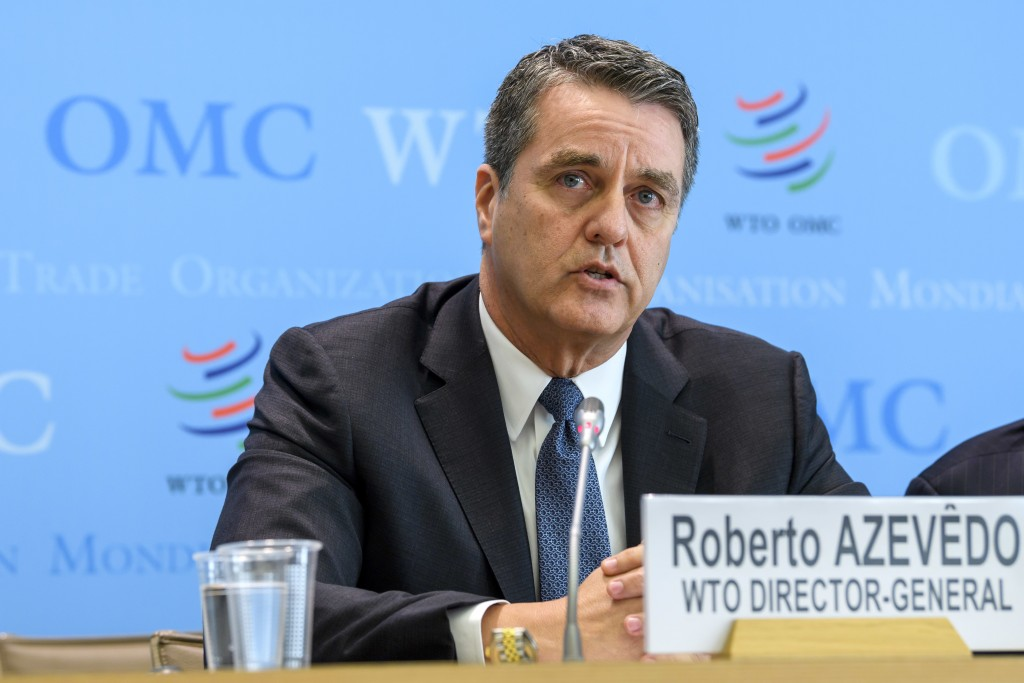 FILE - In this April 12, 2018 file photo Brazilian Roberto Azevedo, Director General of the World Trade Organization, WTO, speaks during a press brief...