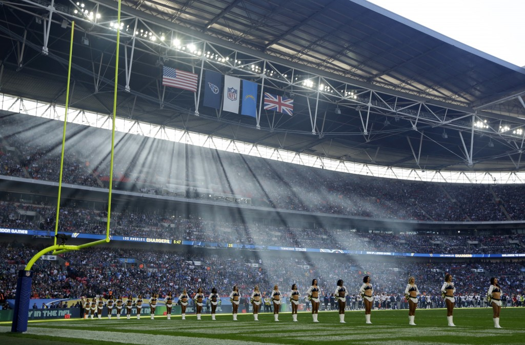 Cheerleaders line up before an NFL football game between Tennessee Titans and Los Angeles Chargers at Wembley stadium in London, Sunday, Oct. 21, 2018