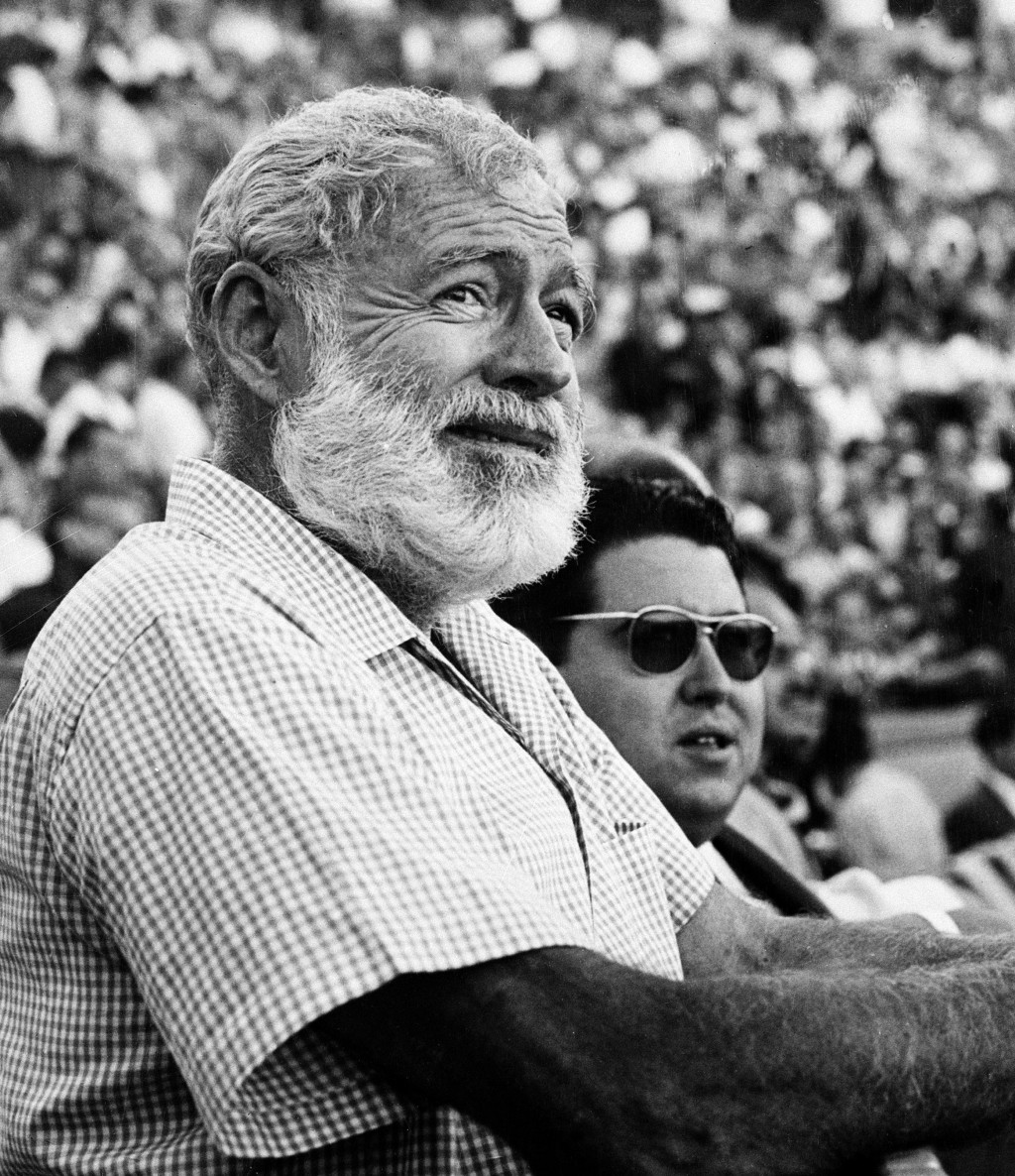 FILE - In this Nov. 1960 file photo, U.S. novelist Ernest Hemingway attends a bullfight in Madrid, Spain. Two Ernest Hemingway stories written in the